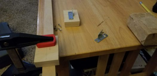 Making the curtain rod clips.