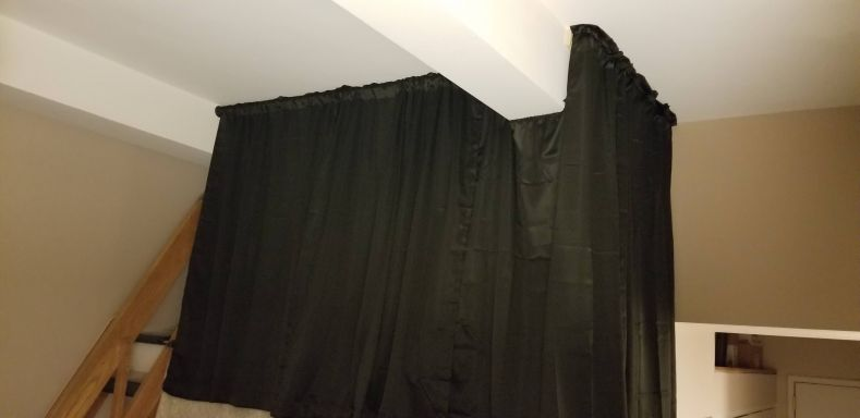 My completed screening curtain, including a dip under the suport beam and a turn around the corner.