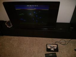 The open, modded, Atari.  Hooked up and working.