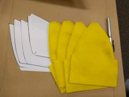 Using printed paper templates, I cut four petals out of yellow felt, and sewed two layers together.