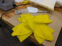 Continuing the process of flower assembly, all four petals are either sewn together already, or pinned in place for sewing.