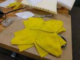 The first half of flower assembly complete:  All four petals are sewn together on one side.  The other side