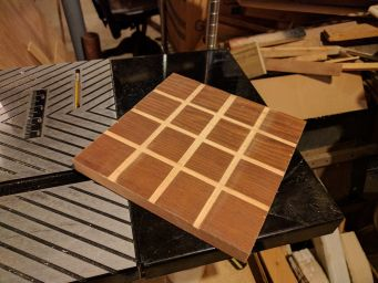 The board is a grid routed into some already-finished wood.
