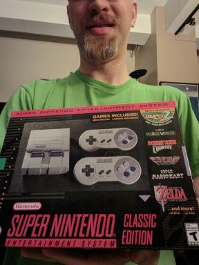 Me proudly holding my SNES Classic.