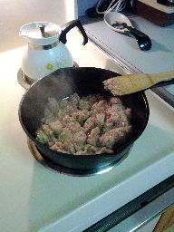 Browning the sausage for the stuffing.