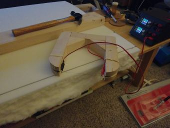 A hot-wire cutter jig, to get the cushion foam cut exactly right.