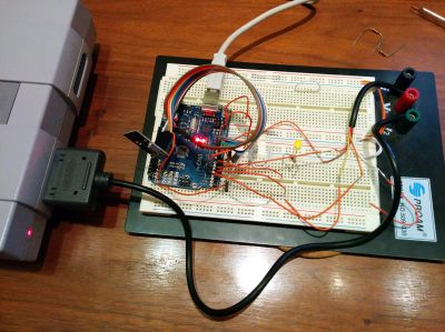 An Arduino Uno board hooked up as a virtual SNES controller.