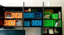 These colorful boxes help me organize my giant collection of video games.